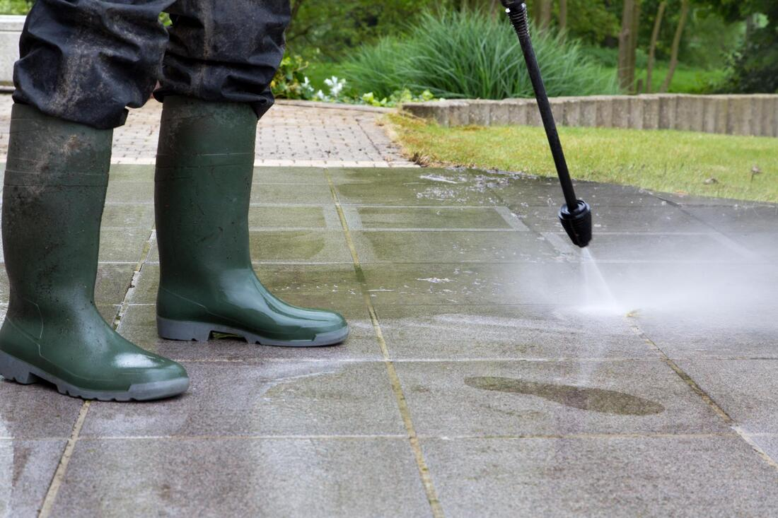 pressure washer doing concrete cleaning